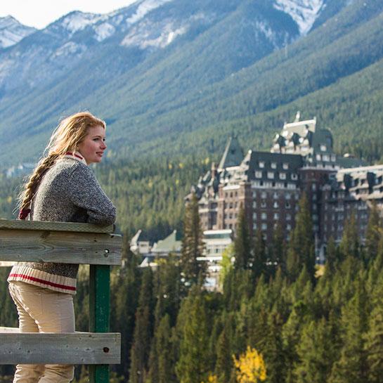 Visitor overlooking Banff Springs hotel