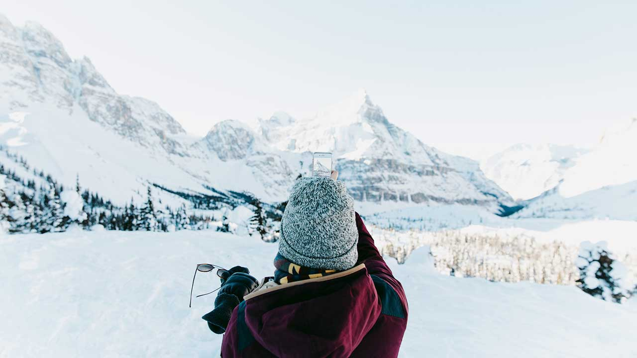 Woman taking photo at Banff National Park