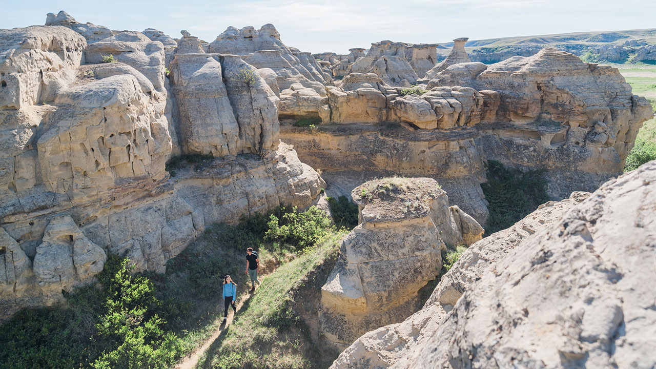 hikers at writing on stone provincial park