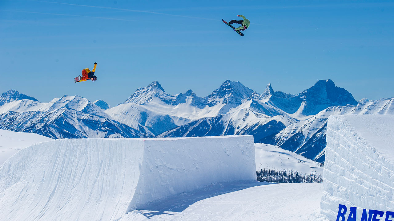 snowboarders in mid air